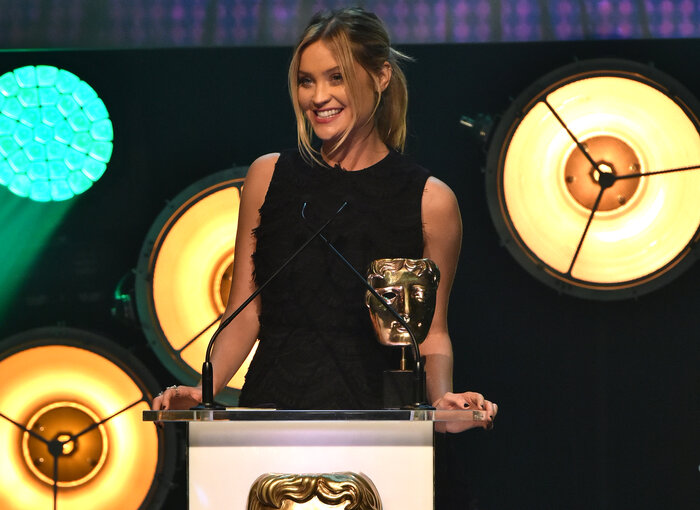 Laura Whitmore presents the award