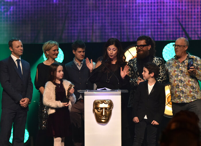 The Topsy and Tim team accept the award