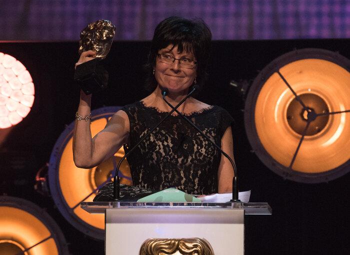 Kay Benbow accepts the award